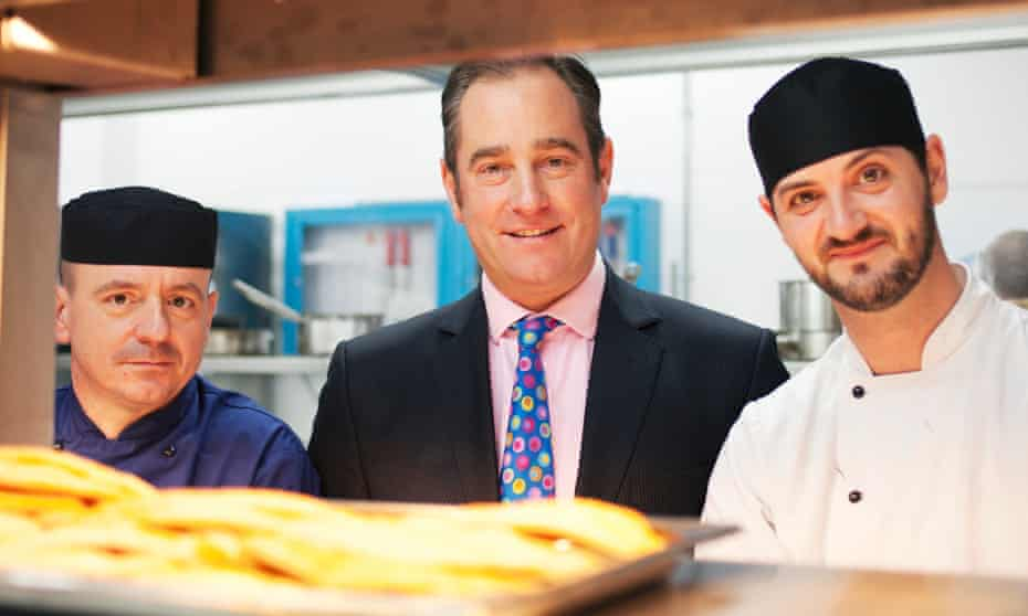 Chris Moore (centre) and inmate-chefs on the clink charity training programme