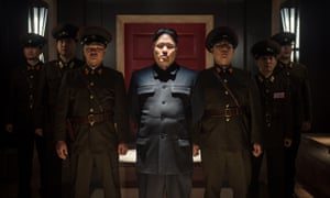 A shot from The Interview, with Kim Jong-un played by Randall Park (c). North Korea entered a protest to the United Nations against the Hollywood comedy before the hack on Sony Pictures.