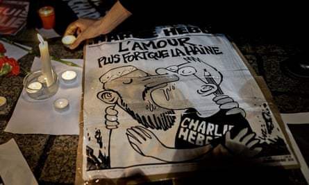 A cartoon outside the French embassy in Berlin after the attack on Charlie Hebdo in Paris