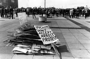 This photograph shows a pile of protest placards stacked on the ground during a meeting of trade unionists at the pierhead, Liverpool. August 1970. Over 3,500 trade unionists took part in the one day strike which was held in protest at the recent arrest of 45 men who were striking at the Shell and Burmah oil refineries. Workers had been campaigning to get paid 3s 6d more per hour.