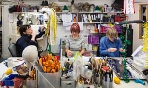 There are usually eight people working at the table in Stephen Jones' studio.