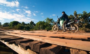 CBD workers traverse difficult terrain to reach some communities. In the wet season, some even have to carry their motorcycles across overflowing rivers