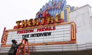 Cinema manager Brandon Delaney changing the marquis of the Plaza Theatre after the cinema announced it would show the controversial movie 'The Interview' in Atlanta, Georgia, USA.
