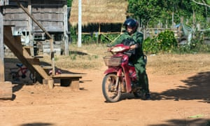 Kongphongma travels to neighbouring villages by motorcycle