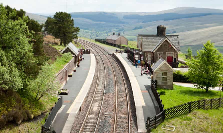 Passengers waiting for a train on the Settle to Carlisle line at Dent Station, Dentdale, Cumbria in the Yorkshire