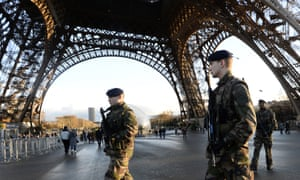French soldiers patrol in front of the Eiffel Tower in Paris as the capital was placed under high alert