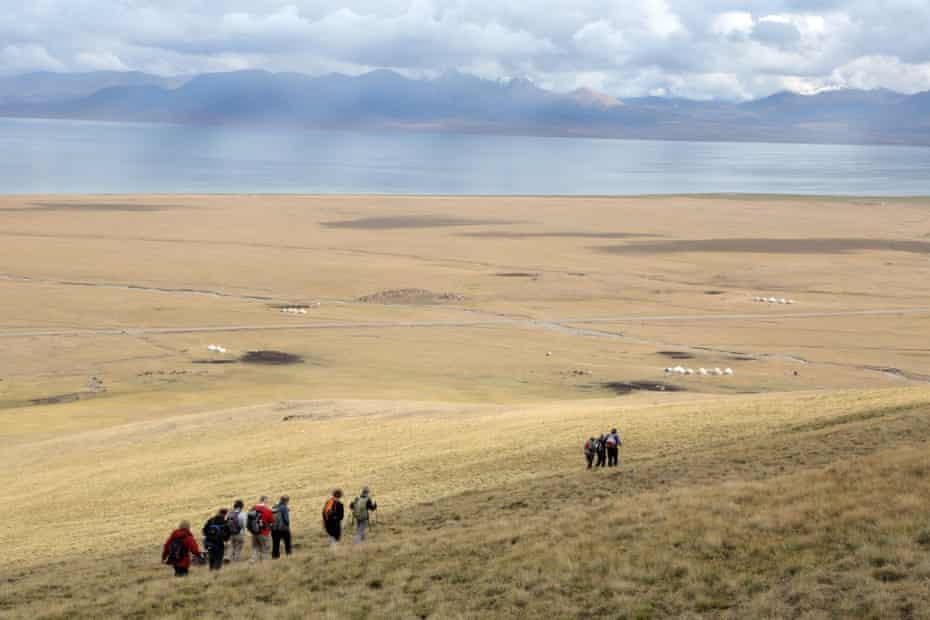 Kevin's group walking above Son Kul Lake.