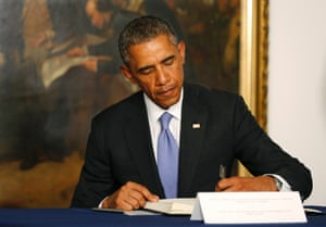 Charlie Hebdo tributes: US president Barack Obama signs a condolences book at the French embassy in Washington