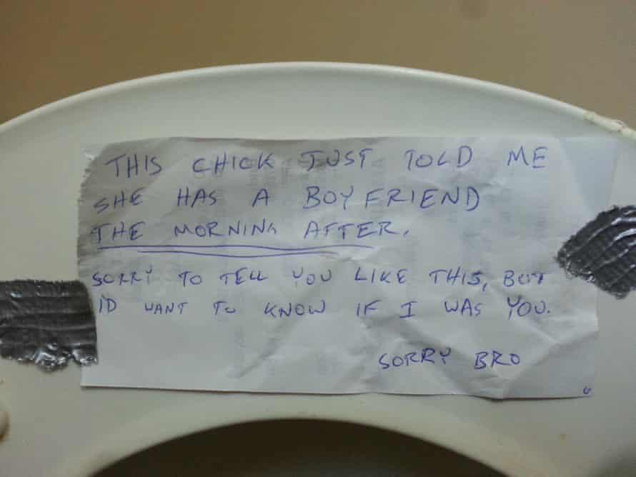 Handwritten note left on underside of a toilet seat