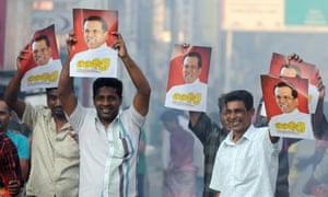 Supporters of Sri Lanka's newly elected president Maithripala Sirisena hold up his poster as they celebrate.