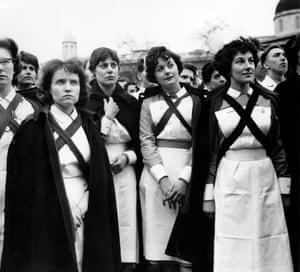 This photograph shows a group of nurses on strike in London in 1962. Renowned Observer photographer Jane Bown captured this photograph on her beloved Rolleiflex camera. Nurses were campaigning for a standard increase in pay and review of working conditions.