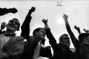 This photograph shows a group of workers at Pilkington Glass Factory striking over £13 a week basic pay, May 1970. The strike, which had been organised by members of the National Union of General and Municipal workers involved more than 8,500 workers. The photograph also shows crop marks made directly onto the print's surface by the picture editor, which were made to reduce the amount of sky at the top of the frame.