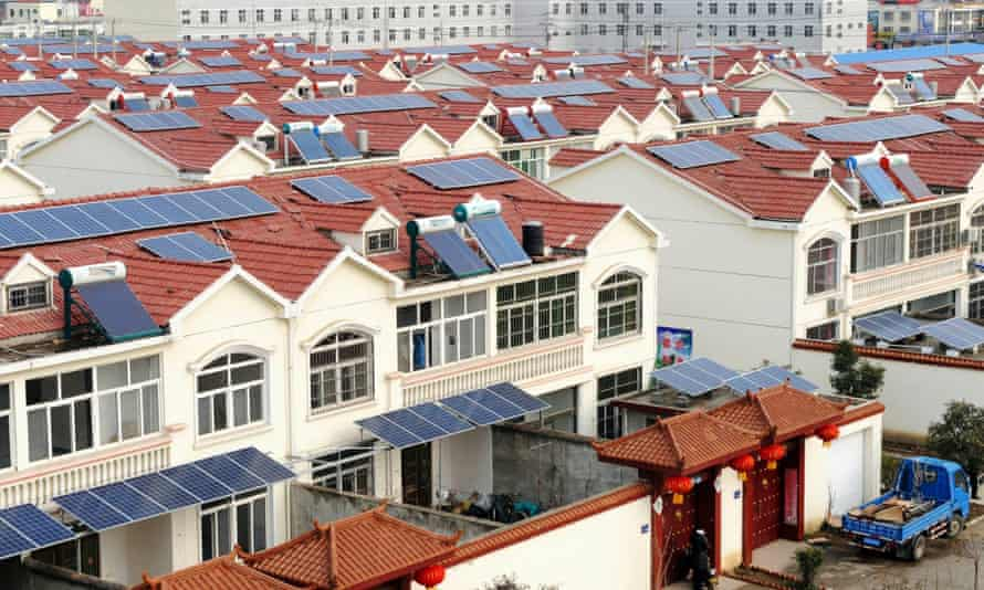 Solar panels on the roofs of residential houses in Qingnan village in Jiangsu province, China. Solar power investment soared in 2014.