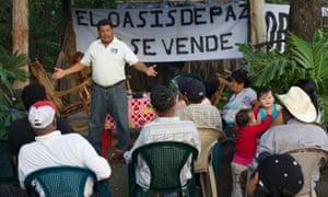 Octavio Ortega speaks to local people who oppose the building of the canal.
