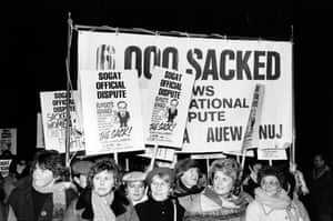 This photograph shows striking print workers supported by Anne Scargill (second from left), wife of the NUM leader Arthur Scargill during their year-long dispute with News International in 1986-7. A year after the miners' strikes, Rupert Murdoch's sacking of print workers and relocation of newspaper production from Fleet Street to a cutting edge new facility in Wapping marked a further decline in the power of trade unions in Britain during the 1980s.