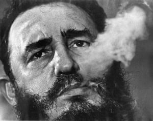 Fidel Castro exhales cigar smoke at his presidential palace in 1985.