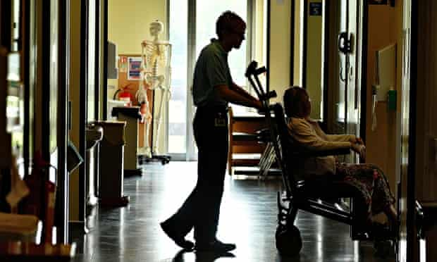 A porter with a patient on birch ward in Hinchingbrooke hospital, Huntingdon.
