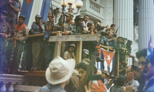 Fidel Castro speaks from a makeshift balcony draped with Cuban flags in Santa Clara en route to victorious entry into Havana.