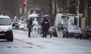 Police inspect the shooting scene in Montrouge, Paris, after a policewoman was shot dead