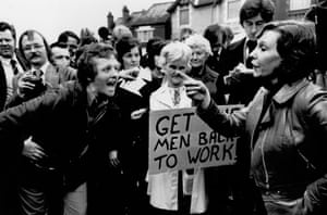 This photograph shows wives of strikers crossing words outside the Chrysler engine factory in Coventy, May 1975. The wives set up opposing picket lines during the strike over pay. Sheila Williams (left) was leader of the strikers' wives who wanted their husbands to return to work whilst Maureen Enever (right) was campaigning for a continued stoppage.