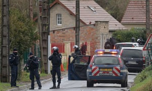 French police special forces in Corcy, near Villers-Cotterets, north-east of Paris, where the two suspects were spotted in a gray Clio