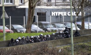 French police take position by the kosher grocery store in Saint-Mande, eastern Paris.