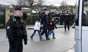 French gendarmes stand by as children are evacuted from a school in Dammartin-en-Goele, north-east of Paris, where two brothers suspected of slaughtering 12 people in an Islamist attack on French satirical newspaper Charlie Hebdo held one person hostage as police cornered the gunmen.