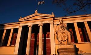 A Greek flag flutters on top Athens University, Greece