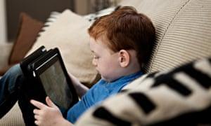 Boy with digital tablet