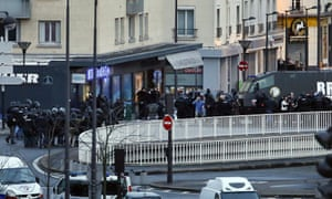 Special forces gather outside a kosher supermarket in east Paris.