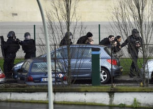 French police special forces evacuate local residents in Saint-Mande, near Porte de Vincennes