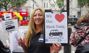 Black taxi cab drivers along with their families protesting outside Downing Street last month.