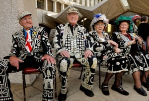 The Pearly Kings and Queens gather at the Guildhall Square to parade to St Mary-le-Bow church.