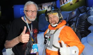 Marv Wolfman, who has donated signing fees to charity, poses with a fan dressed as a character from Star Wars
