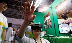 Wearing an Oculus Rift headset to play a video game in the Pocket Queries booth at the this year's Tokyo Game show.