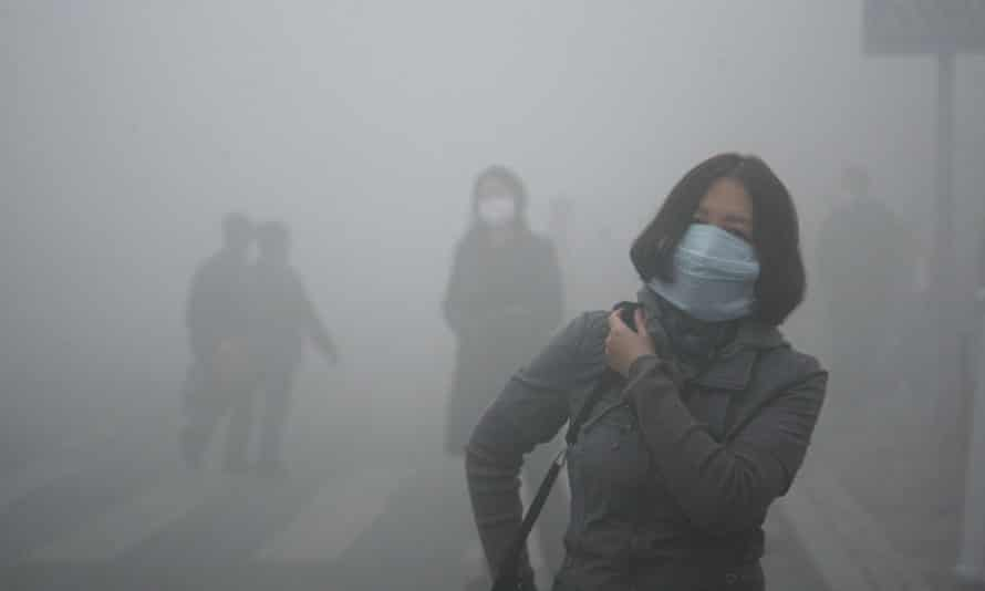 A woman in a mask during heavy smog in Harbin, northern China.