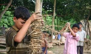 Child helping to make the METI handmade school in Bangladesh.