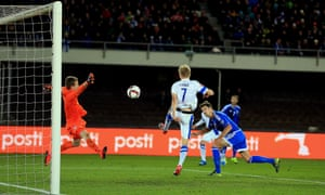 Craig Cathcart's header was cancelled out by Finland's Pauluis Arajuuri but a draw was enough for Northern Ireland to win Group F
