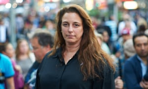 Tania Bruguera amid the hustle and bustle of Times Square, New York.