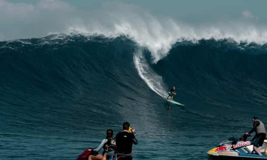 Keala Kennelly flying down a wave at Jaws, Maui.
