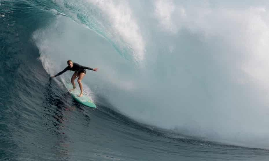 The ride of a lifetime … Paige Alms gets barrelled at the Jaws surf break in Maui, Hawaii