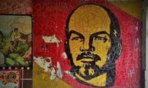 A complete Lenin mural in the rear foyer of a school.