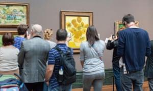 People look at paintings
