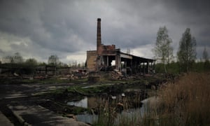 An abandoned factory and boiler house - much of the brickwork and piping was stripped from here and other technical facilities before the road entrances were blocked.