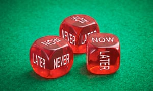Three red die with faces reading now, never and later