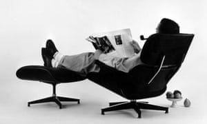 Charles Eames in the plywood Lounge and Ottoman, 1956.