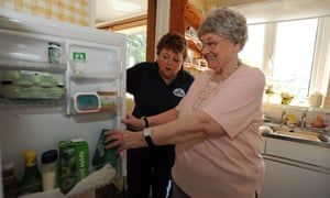 A care workers supports someone in their own home.