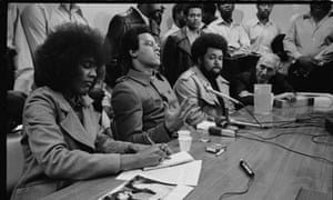 Huey Newton on his return from China, with Elaine Brown