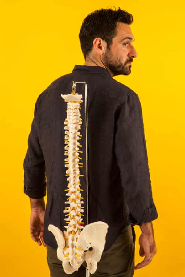 Dara Mohammadi with a replica spine.