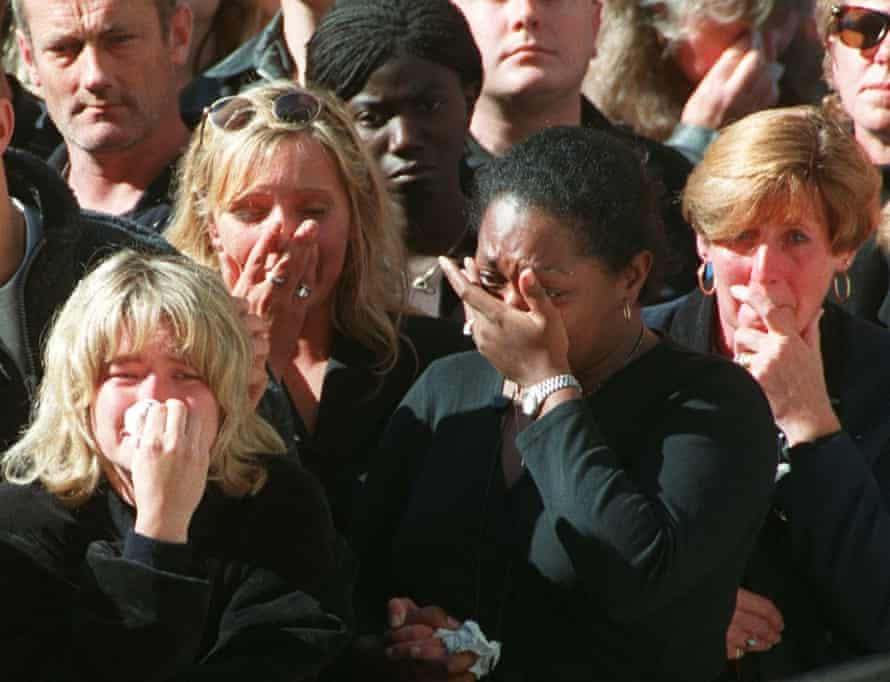 Spectators weep in the crowd along London's Whitehall during funeral ceremonies for Princess Diana.